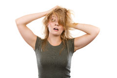 Crazy, mad blonde woman with messy hair Stock Image