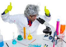 Crazy mad nerd scientist at laboratory microscope. Ok hand sign gesture Royalty Free Stock Images