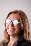 Crazy mad nerdy woman with glasses Stock Images