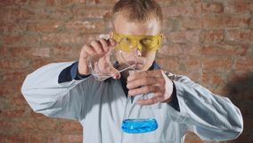 Crazy, mad scientist conducting a chemical experiment in laboratory royalty free stock photo