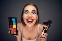 Crazy make up artist with clown worst make up. royalty free stock photos