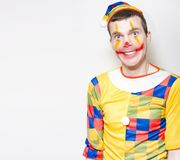 Crazy Male Birthday Party Clown With Funny Smile. Crazy Birthday Party Male Entertainer In Clown Costume Smiling On Copy Space Background Royalty Free Stock Images