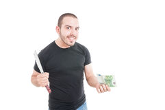 Crazy male with sharp knife and money Royalty Free Stock Photography