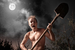 Crazy man. Anger crazy man with spade stock image