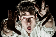 Crazy Man Acting like a Zombie Royalty Free Stock Photo