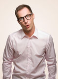 Crazy man amazed. A crazy man with nerd glasses Royalty Free Stock Photography