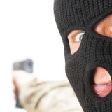 Crazy man in black mask holding gun - close up Royalty Free Stock Photo