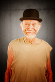 Crazy man in bowler hat. Crazy senior man in bowler hat on white background stock photography