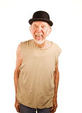 Crazy man in bowler hat. Crazy senior man in bowler hat sticking out his tongue royalty free stock images
