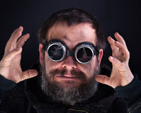 Crazy man with broken goggles Royalty Free Stock Image