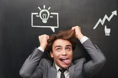 Crazy man with chalked graphs painted on Royalty Free Stock Photography