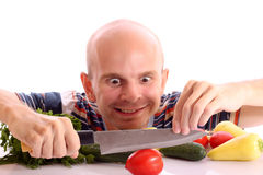 Crazy man cooking. With tomato, cucumber, pepper and onion on white background stock images