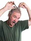 Crazy man cuts his hair. Cut hair man crazy isolated barber hairstyle Royalty Free Stock Image