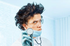 Crazy man doctor with stethoscope Stock Image