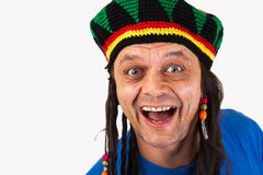 A crazy man with dreadlocks wig. Isolated Stock Photo