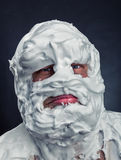 Crazy man with face completely in shaving foam Royalty Free Stock Photo