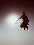 Crazy man is flying over Sun on blue sky background. Stock Photography