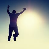 Crazy man is flying over Sun on blue sky background. Stock Images