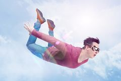 Crazy man in goggles is flying in in the cloudy sky. Jumper concept stock photography