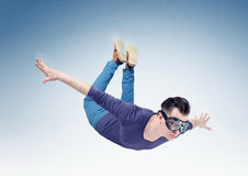 Crazy man in goggles is flying in the sky. Jump from orbit.  Royalty Free Stock Photos