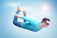 Crazy man in goggles is flying in the sky. Jumper concept Stock Image