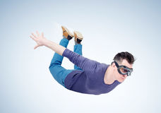 Crazy man in goggles is flying in the sky. Jumper concept stock photo
