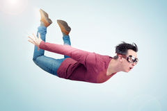 Crazy man in goggles is flying in the sky. Jumper concept Stock Images