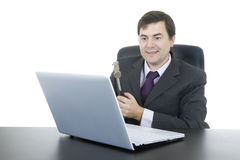 Crazy man. Happy business man with a hammer smashing a laptop, isolated Royalty Free Stock Photo