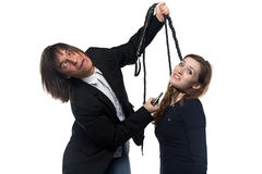 Crazy man in jacket holding woman with whip Stock Images