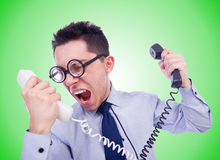 The crazy man with phone on white Royalty Free Stock Photos