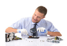 Crazy man reconditioning hard drive. Concept humor repair computer Royalty Free Stock Images