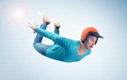 Crazy man in red helmet is flying in the sky. Jumper concept. On blue background Stock Images
