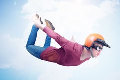 Crazy man in red helmet and goggles is flying in the sky. Jumper concept.  Royalty Free Stock Image
