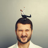 Crazy man rolling on the head Stock Image