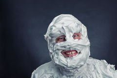 Crazy man with shaving foam on his face. Over grey background royalty free stock image