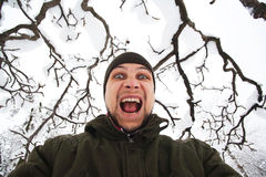 Crazy man shouting. Outdoors in winter stock images