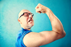 Crazy man showing  proudly  its muscles Stock Image