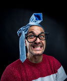 Crazy man with tie on his head, corporate party Royalty Free Stock Photos