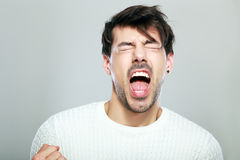 Crazy man yelling. With his eyes closes studio portrait royalty free stock images