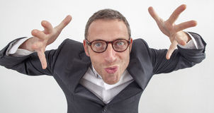 Crazy manager playing with hands for scaring or threatening employee Stock Images