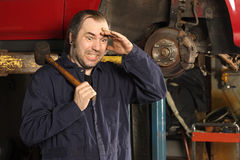 Crazy mechanic confused Stock Image