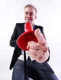 The crazy men. A crazy businessman shouting through a megaphone Royalty Free Stock Photos