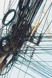 Crazy messy chaos wires cables on Electric poles. Crazy messy chaos wires cables on Electric poles royalty free stock images