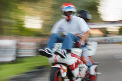 Crazy motorbike driver Stock Images