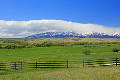 Crazy Mountains, meadow and fence Royalty Free Stock Photography