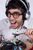 Crazy about music. Crazy young man eating music at his dinner plate Royalty Free Stock Photos