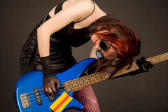 Crazy musician with bass guitar royalty free stock image