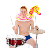 Crazy musician with drums on holiday Royalty Free Stock Photo