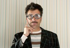 Crazy nerd man myopic thinking funny gesture. Crazy nerd man myopic thinking gesture expression funny glasses man Royalty Free Stock Images