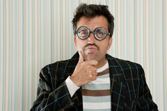 Crazy nerd man myopic thinking funny gesture Stock Photos